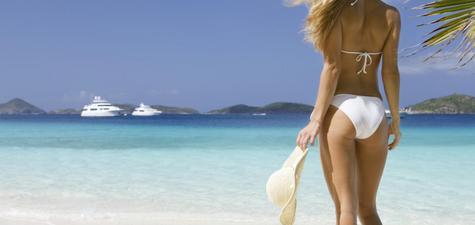 image-Woman-on-tropical-beach-with-yacht.jpg